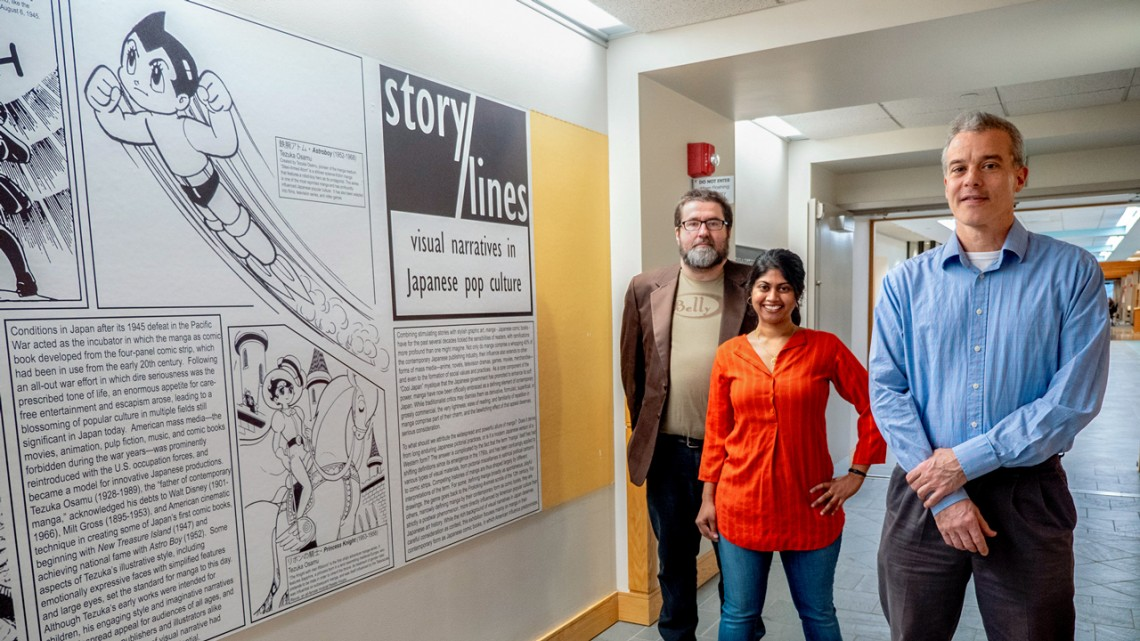 "From left, Karl Rozyn, Aparna Ghosh and Dan McKee, collaborated on the manga exhibit, ""Story/Lines: Visual Narratives in Japanese Pop Culture,"" in the first-floor hallway of Carl A. Kroch Library."